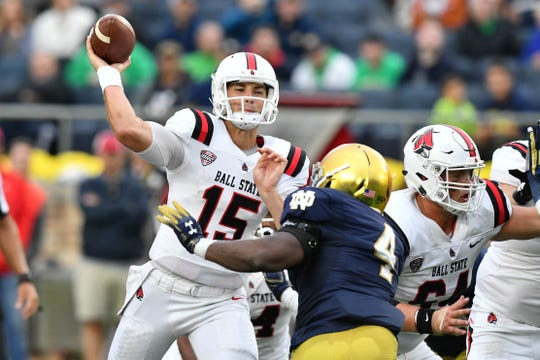 Sep 8, 2018; South Bend, IN, USA; Ball State Cardinals quarterback Riley Neal (15) throws under pressure from Notre Dame Fighting Irish linebacker Te'von Coney (4) in the fourth quarter at Notre Dame Stadium. Mandatory Credit: Matt Cashore-USA TODAY Sports