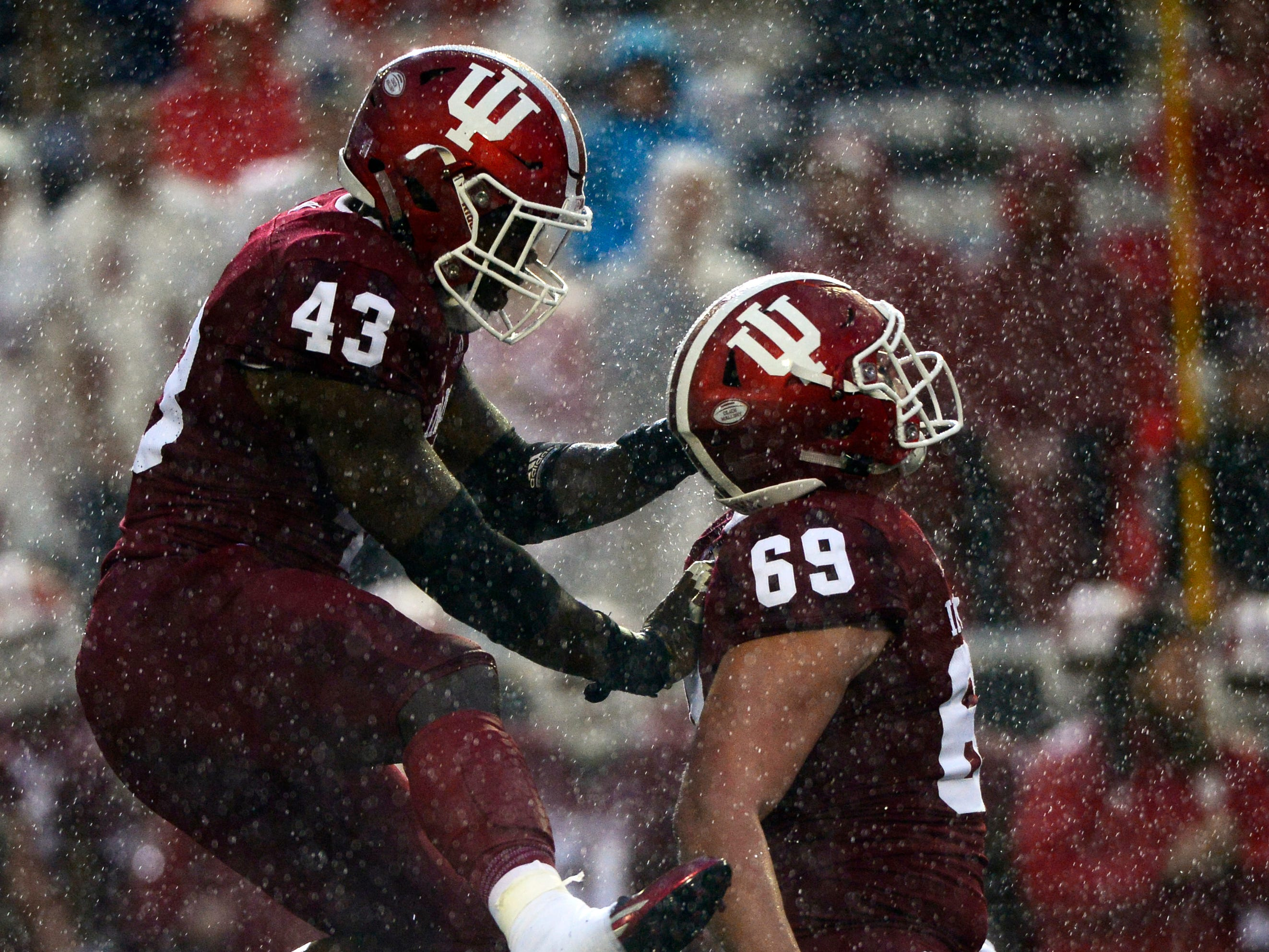 Indiana Hoosiers linebacker Dameon Willis Jr. (43) celebrates with defensive lineman Gavin Everett (69) after Everett made a tackle during the game against Virginia at Memorial Stadium in Bloomington, Ind., on Saturday, Sept. 8, 2018.