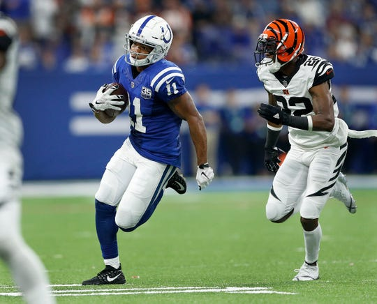 Indianapolis Colts wide receiver Ryan Grant (11) runs away from Cincinnati Bengals cornerback William Jackson (22) in the second half of their game at Lucas Oil Stadium on Sept. 9, 2018. The Indianapolis Colts lost to the Cincinnati Bengals 34-23.