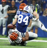 Cincinnati Bengals linebacker Hardy Nickerson (56) and safety Clayton Fejedelem (42) force Indianapolis Colts tight end Jack Doyle (84) to fumble the ball late in the fourth quarter of their game at Lucas Oil Stadium on Sept. 9, 2018. The Indianapolis Colts lost to the Cincinnati Bengals 34-23.