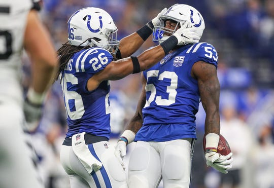Indianapolis Colts linebacker Darius Leonard (53) celebrates a fumble recovery with Indianapolis Colts defensive back Clayton Geathers (26) against the Cincinnati Bengals at Lucas Oil Stadium on Sunday, Sept. 9, 2018.