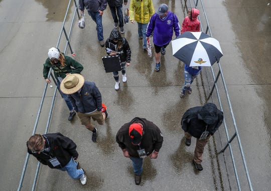 NASCAR fans left Indianapolis Motor Speedway after the Brickyard 400 was postponed because of rain on Sunday, Sept. 9, 2018. The race was run on Monday.