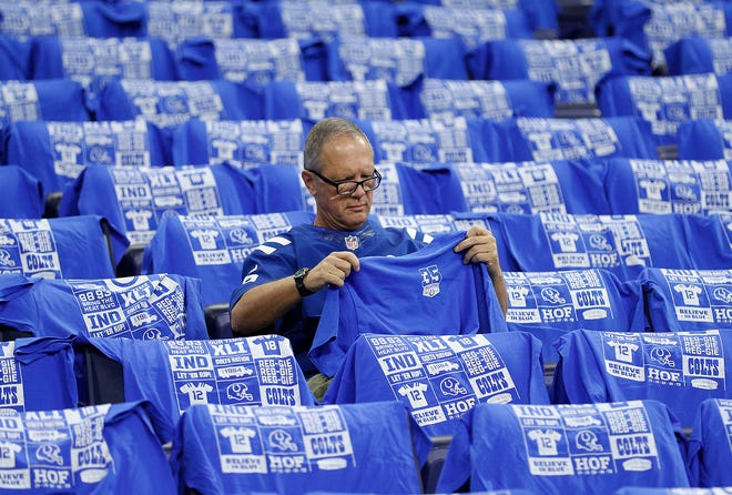Indianapolis Colts fans got a free T-shirt on their seat before the start of their game against the Cincinnati Bengals at Lucas Oil Stadium on Sept. 9.