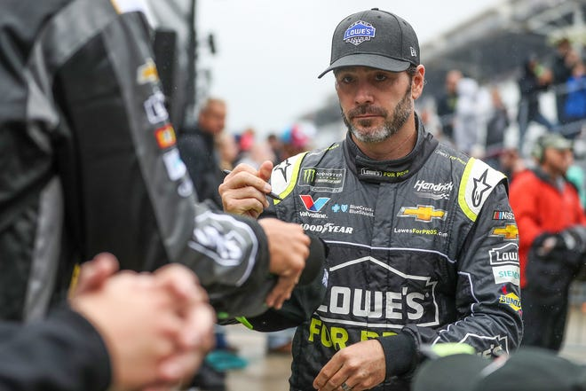 Monster Energy NASCAR Cup Series driver Jimmie Johnson greets fans during his introduction before the Brickyard 400 at Indianapolis Motor Speedway on Sunday, Sept. 9, 2018.
