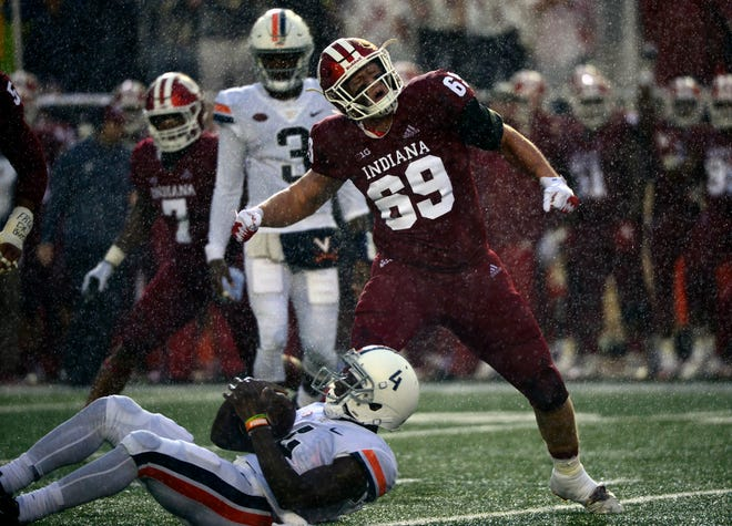 Indiana Hoosiers defensive lineman Gavin Everett (69) celebrates after making a tackle during the game against Virginia at Memorial Stadium in Bloomington, Ind., on Saturday, Sept. 8, 2018.