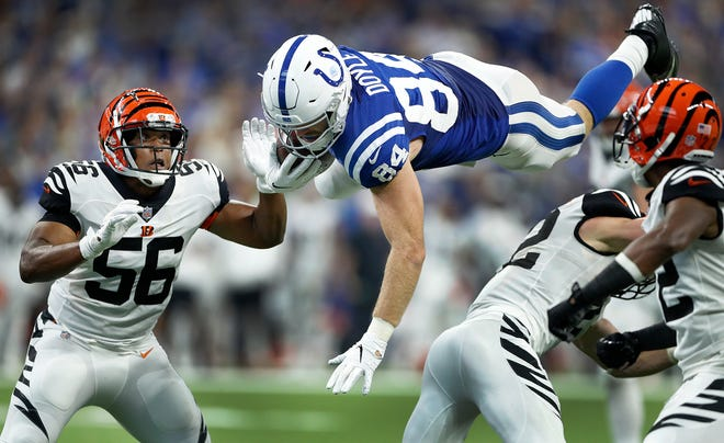 Indianapolis Colts tight end Jack Doyle (84) flies through the air after getting hit as Cincinnati Bengals linebacker Hardy Nickerson (56) looks on in the second half of their game at Lucas Oil Stadium on Sept. 9, 2018. The Indianapolis Colts lost to the Cincinnati Bengals 34-23.