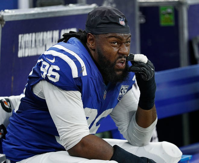 A dejected Indianapolis Colts defensive end Denico Autry (96) sit on the bench late in the fourth quarter of their game at Lucas Oil Stadium on Sept. 9, 2018. The Indianapolis Colts lost to the Cincinnati Bengals 34-23.