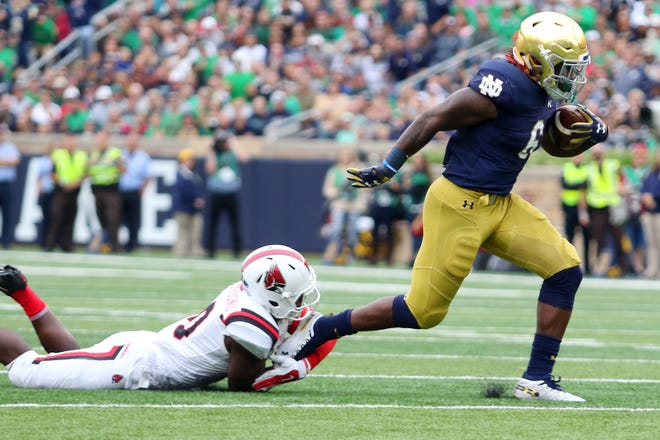 Notre Dame Fighting Irish running back Tony Jones Jr. (6)Runs the ball against the Ball State Cardinals.Notre Dame defeats Ball State 24-16. At Notre Dame Stadium in South Bend, Ind., on Saturday, Sept. 8, 2018