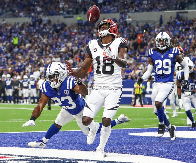 Cincinnati Bengals wide receiver A.J. Green (18) bobbles the ball in the end zone against the Indianapolis Colts at Lucas Oil Stadium on Sunday, Sept. 9, 2018.