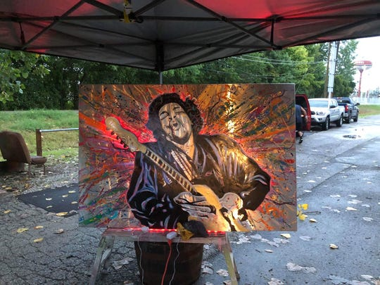 This art piece inpired by Jimi Hendrix was created by artist Gavin Goode and will be auctioned during Carmel PorchFest 2018. It was made with two sheets of layered stainless steel and it has LED lighting that changes color with a remote.
