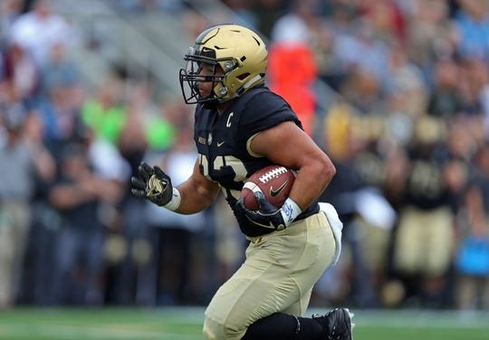 Sep 8, 2018; West Point, NY, USA; Army Black Knights running back Darnell Woolfolk (33) runs for a touchdown against the Liberty Flames during the first half at Michie Stadium. Mandatory Credit: Danny Wild-USA TODAY Sports
