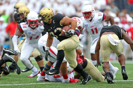 Sep 8, 2018; West Point, NY, USA; Army Black Knights running back Darnell Woolfolk (33) runs with the ball against the Liberty Flames during the second half at Michie Stadium. Mandatory Credit: Danny Wild-USA TODAY Sports