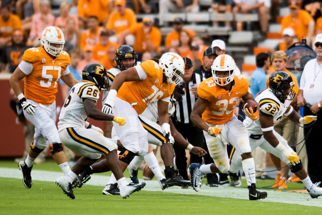 Tennessee running back Jeremy Banks (33) runs down the field against ETSU on Saturday at Neyland Stadium.