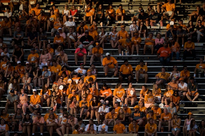 Evening sunlight bathes fans in the stands during a game between Tennessee and ETSU at Neyland Stadium in Knoxville, Tennessee on Saturday, September 8, 2018.