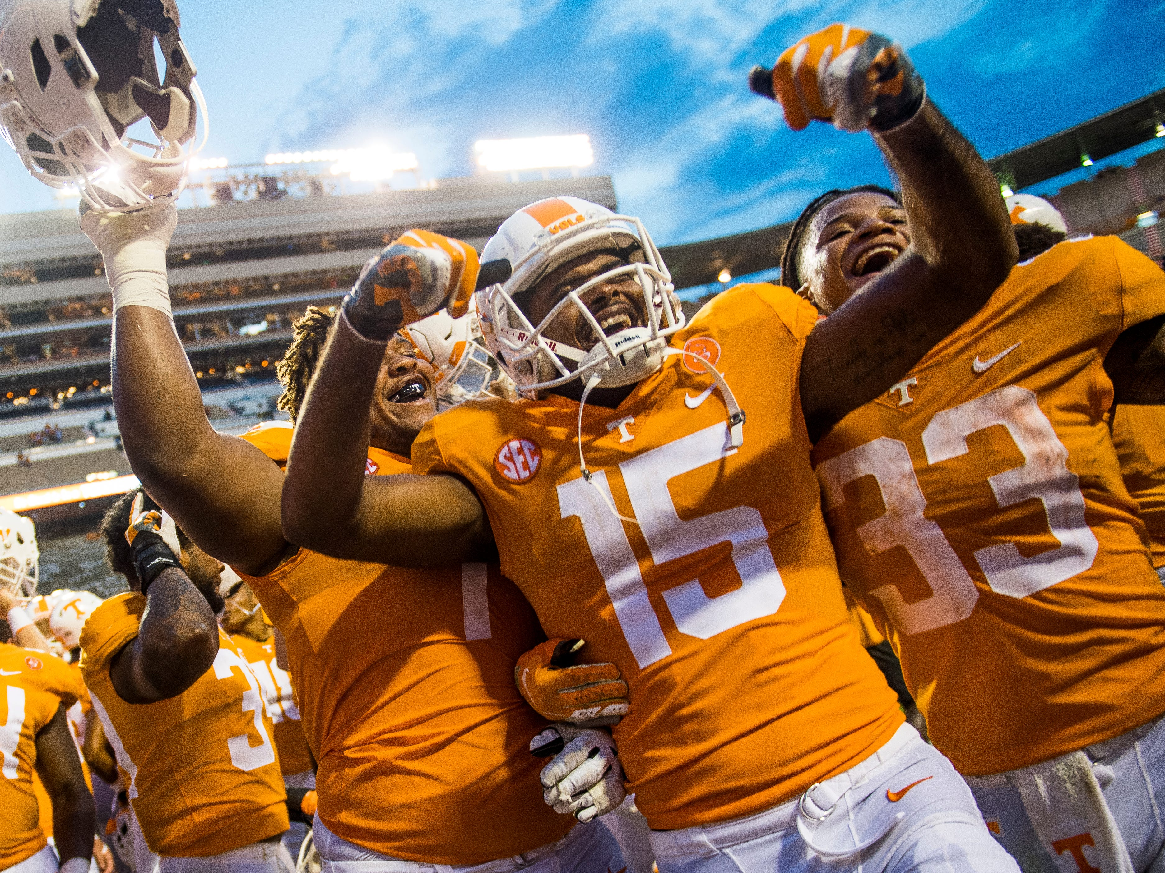 Tennessee offensive lineman K'Rojhn Calbert (74), Tennessee wide receiver Jauan Jennings (15) and Tennessee running back Jeremy Banks (33) celebrate the Tennessee Volunteers' 59-3 victory against ETSU in Neyland Stadium on Saturday, Sept. 8, 2018.