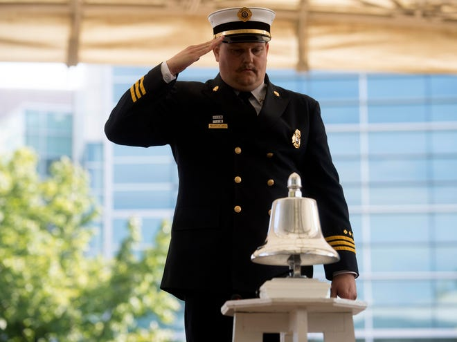 Oak Ridge Fire Department Fire Marshal Travis Solomon salutes after tolling the bell in a ceremony at the Worlds Fair Park Amphitheater for the 17th Anniversary 9-11 Remembrance Ride on Sunday, September 9, 2018.