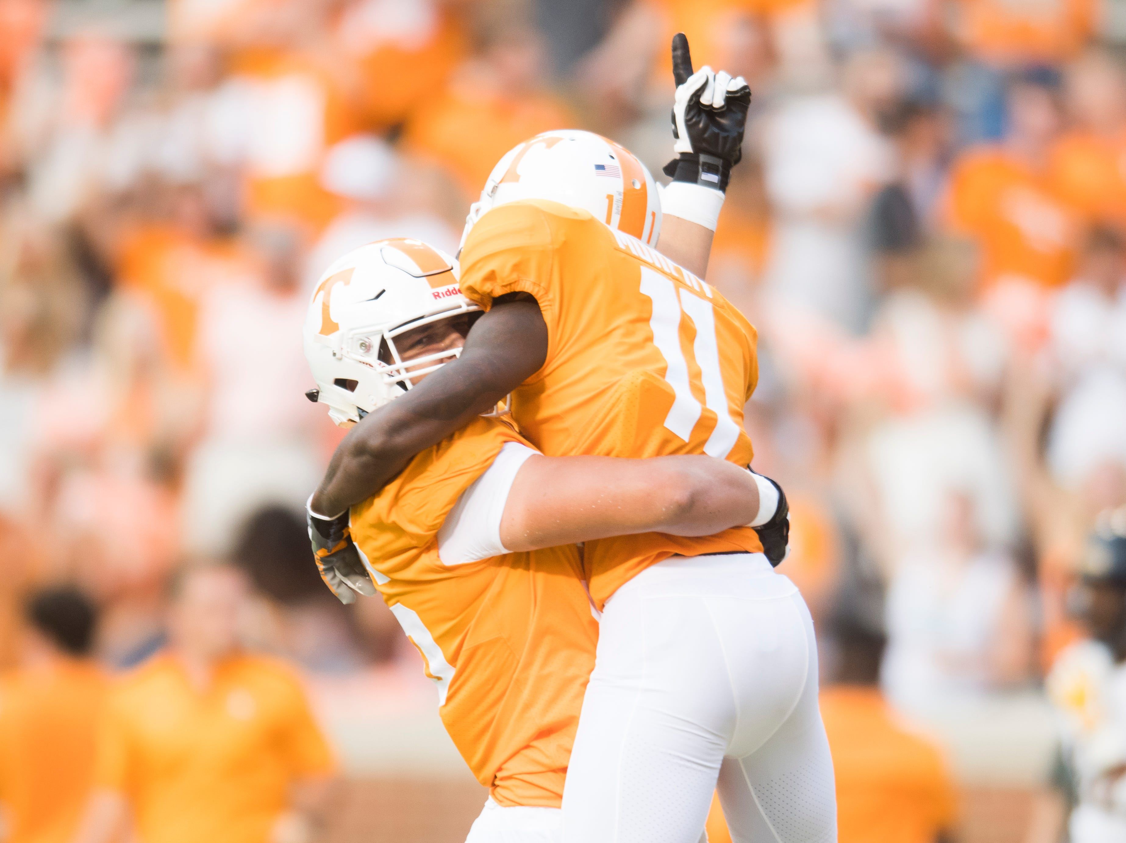 Tennessee offensive lineman Riley Locklear (56) congratulates Tennessee wide receiver Jordan Murphy (11) on a touchdown during a game between Tennessee and ETSU at Neyland Stadium in Knoxville, Tennessee on Saturday, September 8, 2018.