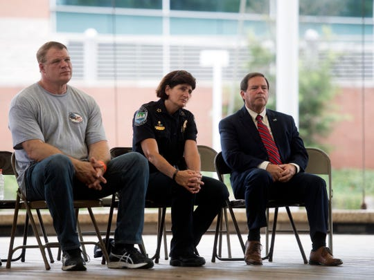 Knox County Mayor Glenn Jacobs, Knoxville Police Chief Eve Thomas, and Knox County Sheriff Tom Spangler attend the ceremony of the 17th Anniversary 9-11 Remembrance Ride on Sunday, September 9, 2018 at the World's Fair Park Amphitheater.