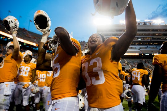 Tennessee running back Jeremy Banks (33) celebrates with  Tennessee wide receiver Jauan Jennings (15) during a game between Tennessee and ETSU at Neyland Stadium in Knoxville, Tennessee on Saturday, September 8, 2018.