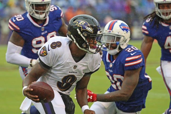 Sep 9, 2018; Baltimore, MD, USA; Baltimore Ravens quarterback Lamar Jackson (8) defended on a run by Buffalo Bills safety Rafael Bush (20) at M&T Bank Stadium.