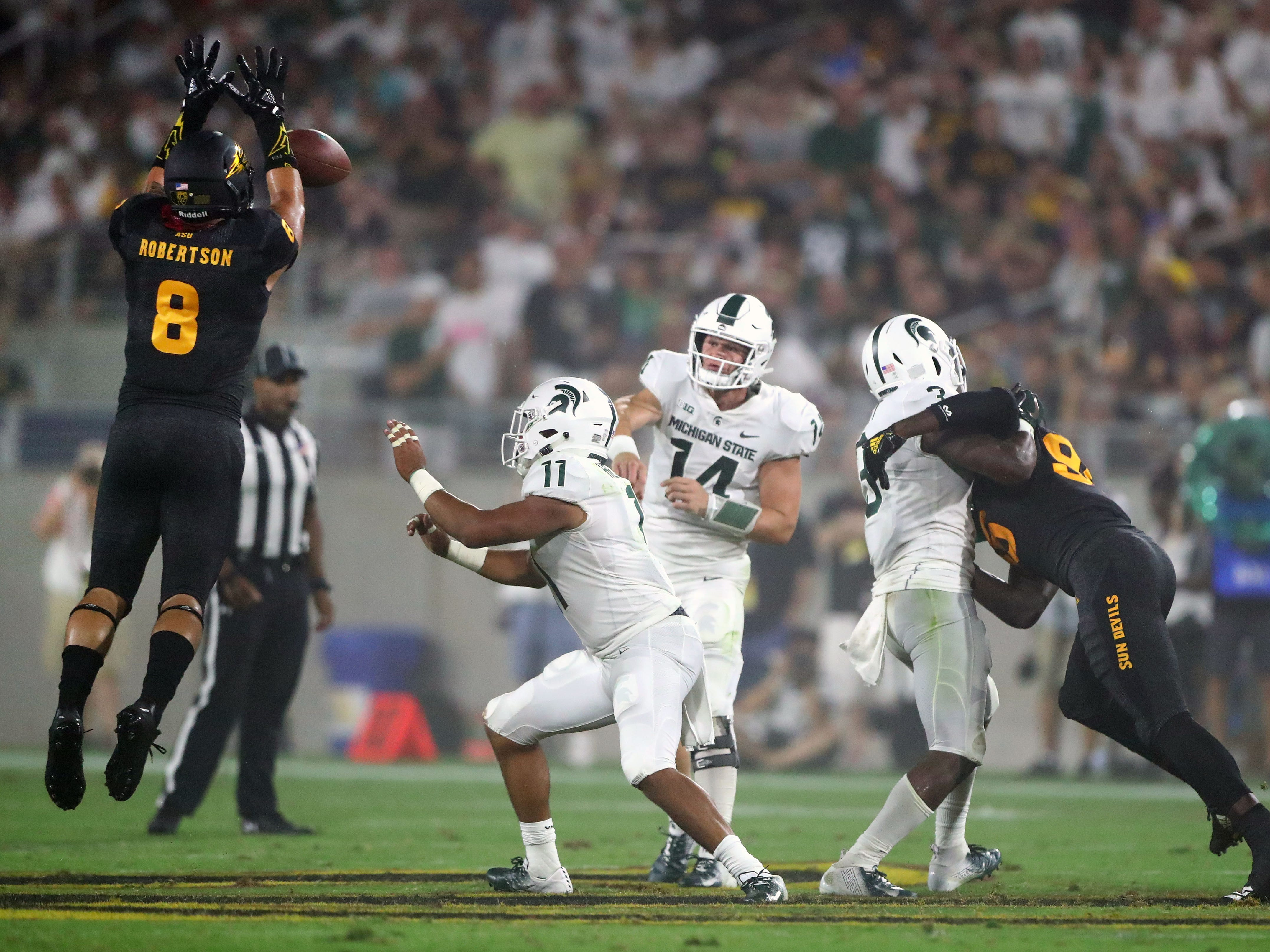 Arizona State Sun Devils linebacker Merlin Robertson (8) blocks the pass by Michigan State Spartans quarterback Brian Lewerke (14) in the first half at Sun Devil Stadium.