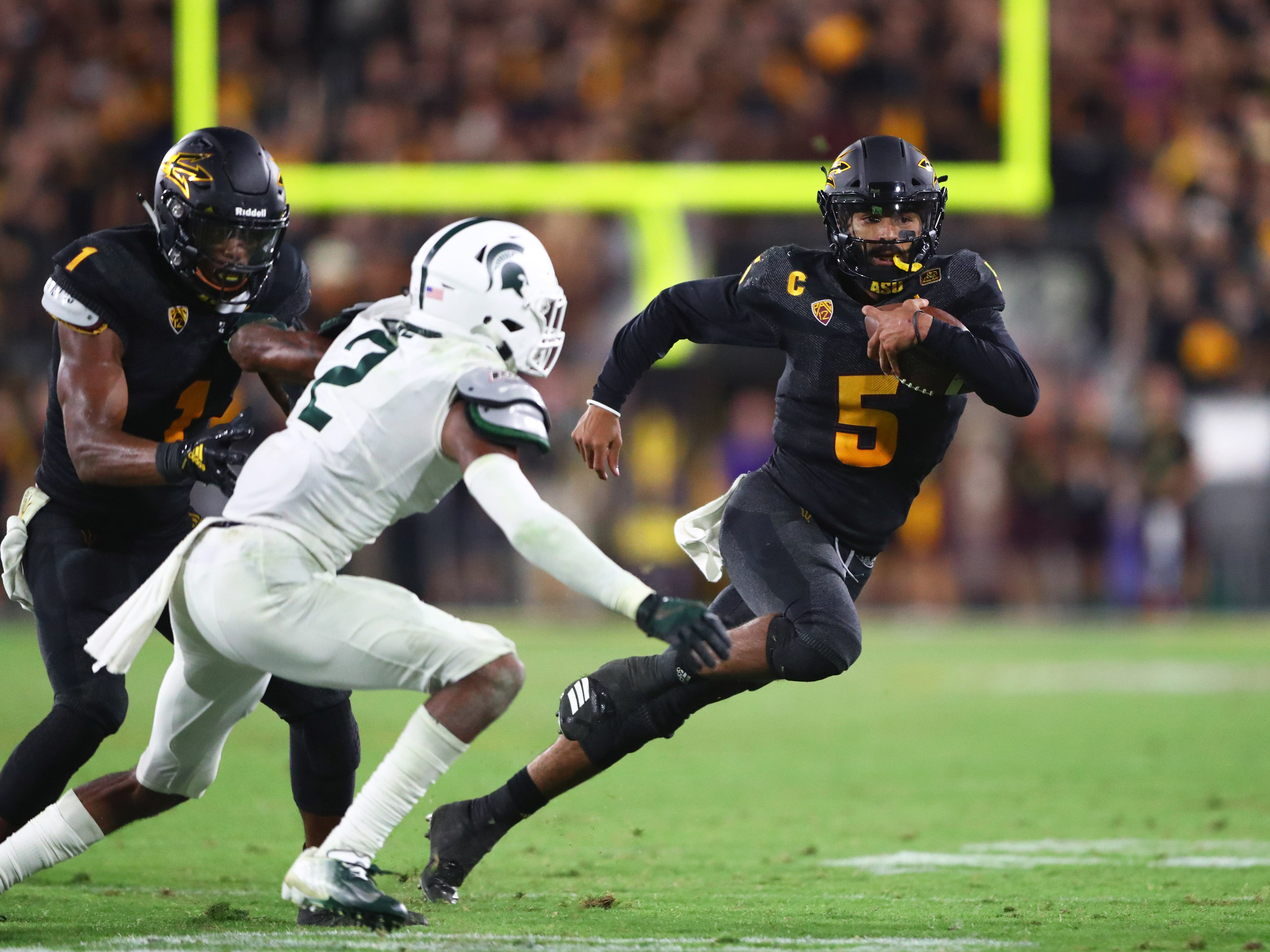 Arizona State Sun Devils quarterback Manny Wilkins (5) runs the ball in the fourth quarter against the Michigan State Spartans at Sun Devil Stadium.