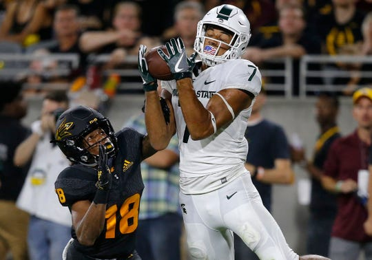 Michigan State wide receiver Cody White (7) makes a touchdown catch in front of Arizona State cornerback Langston Frederick (18) during the second half of an NCAA college football game Saturday, Sept. 8, 2018, in Tempe, Ariz. Arizona State defeated Michigan State 16-13.