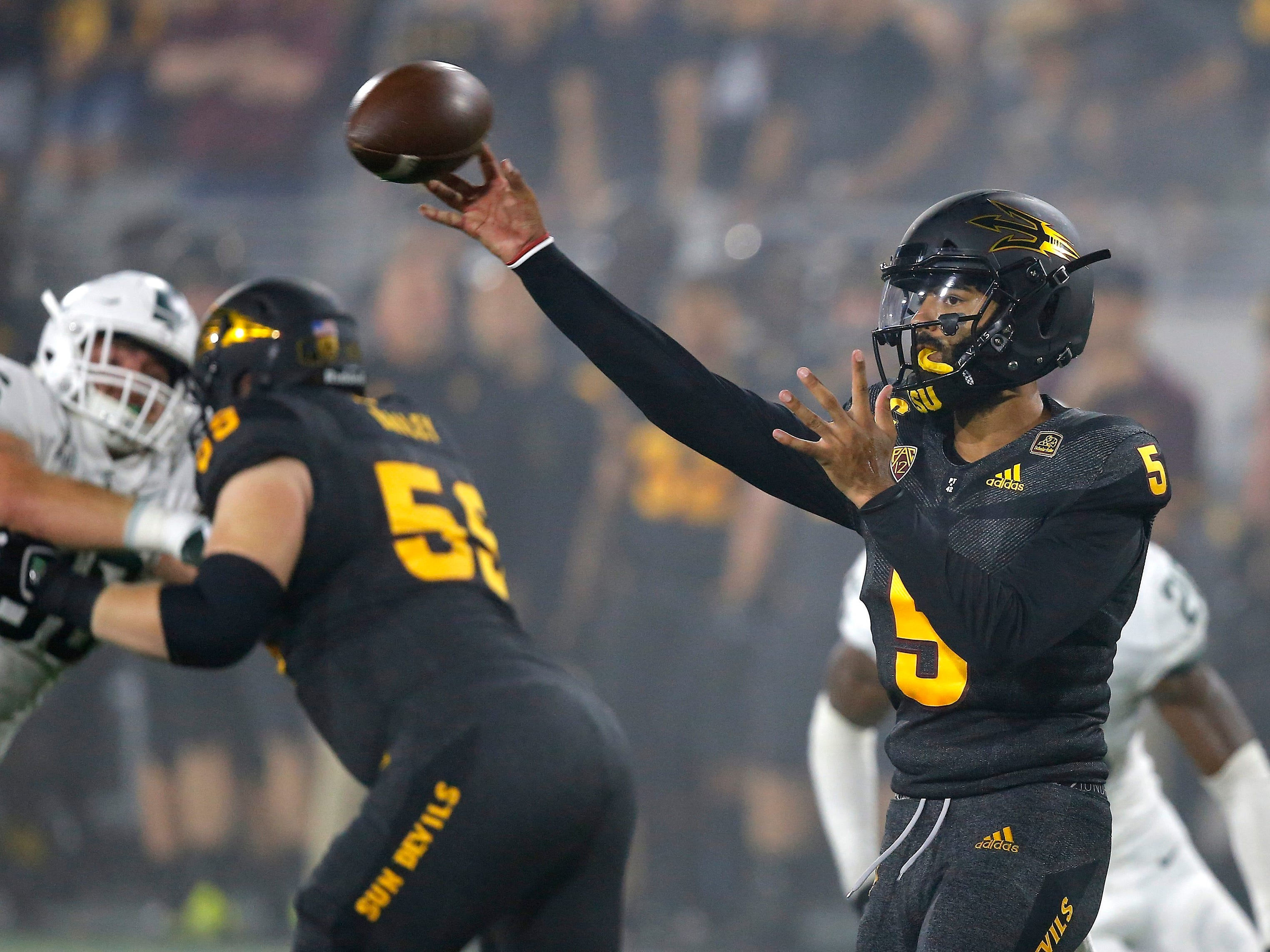 Arizona State quarterback Manny Wilkins (5) throws a pass against Michigan State during the first half of an NCAA college football game Saturday, Sept. 8, 2018, in Tempe, Ariz.