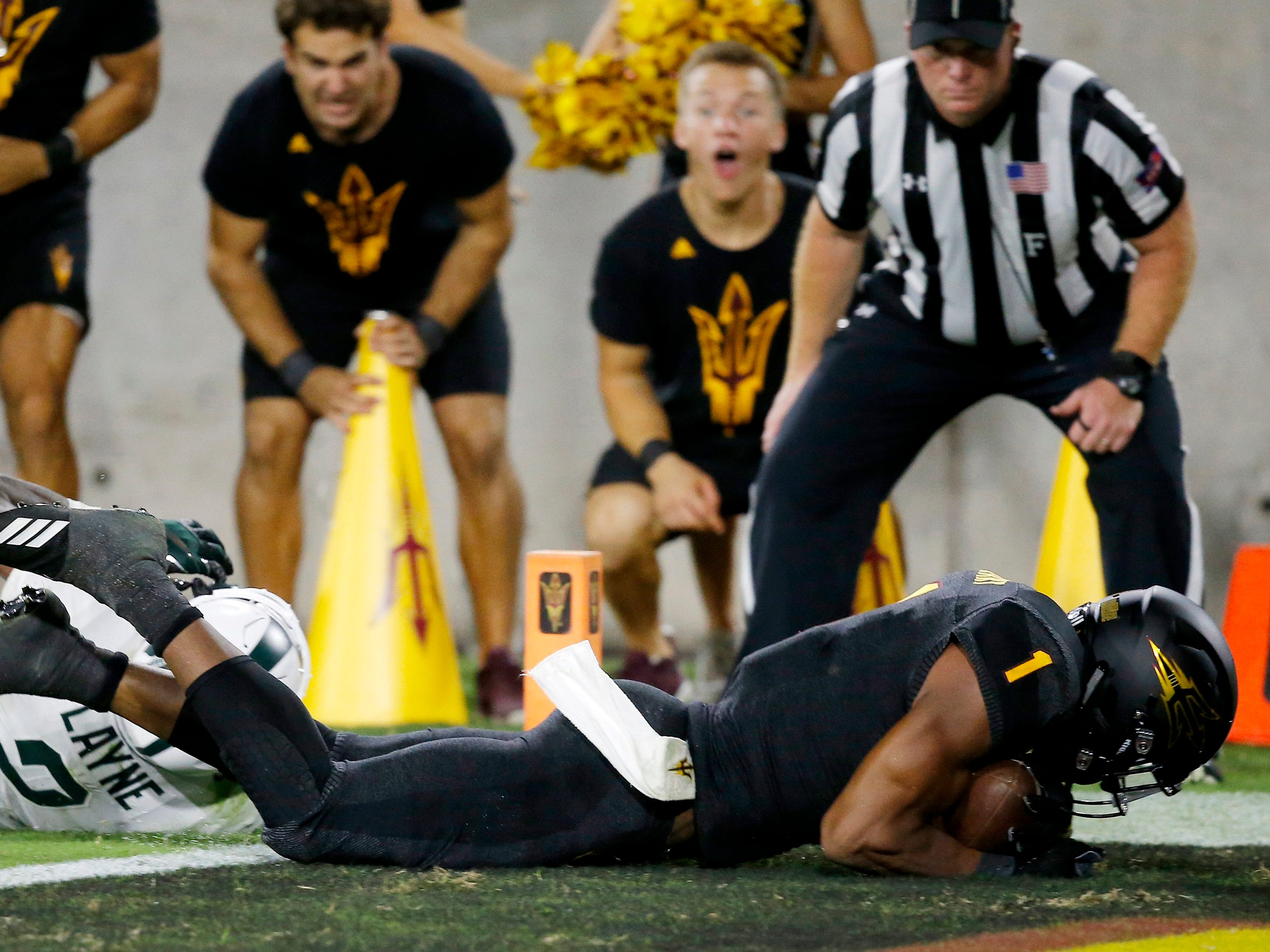 Arizona State wide receiver N'Keal Harry (1) dives into the end zone for a touchdown as he gets past Michigan State cornerback Justin Layne (2) during the second half of an NCAA college football game Saturday, Sept. 8, 2018, in Tempe, Ariz. Arizona State defeated Michigan State 16-13.