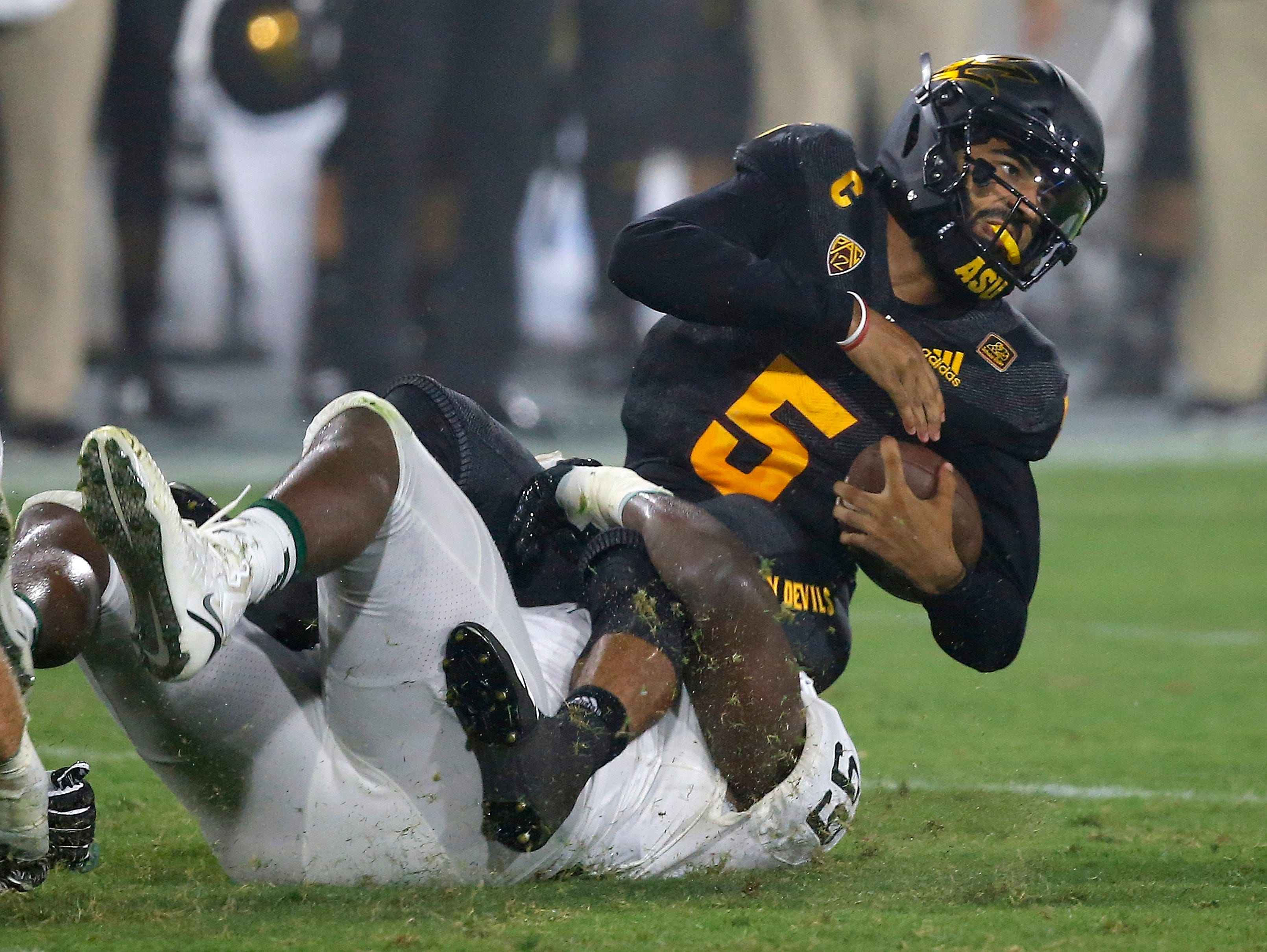 Arizona State quarterback Manny Wilkins (5) gets tackled by Michigan State defensive tackle Raequan Williams (99) during the first half of an NCAA college football game Saturday, Sept. 8, 2018, in Tempe, Ariz. (AP Photo/Ross D. Franklin)