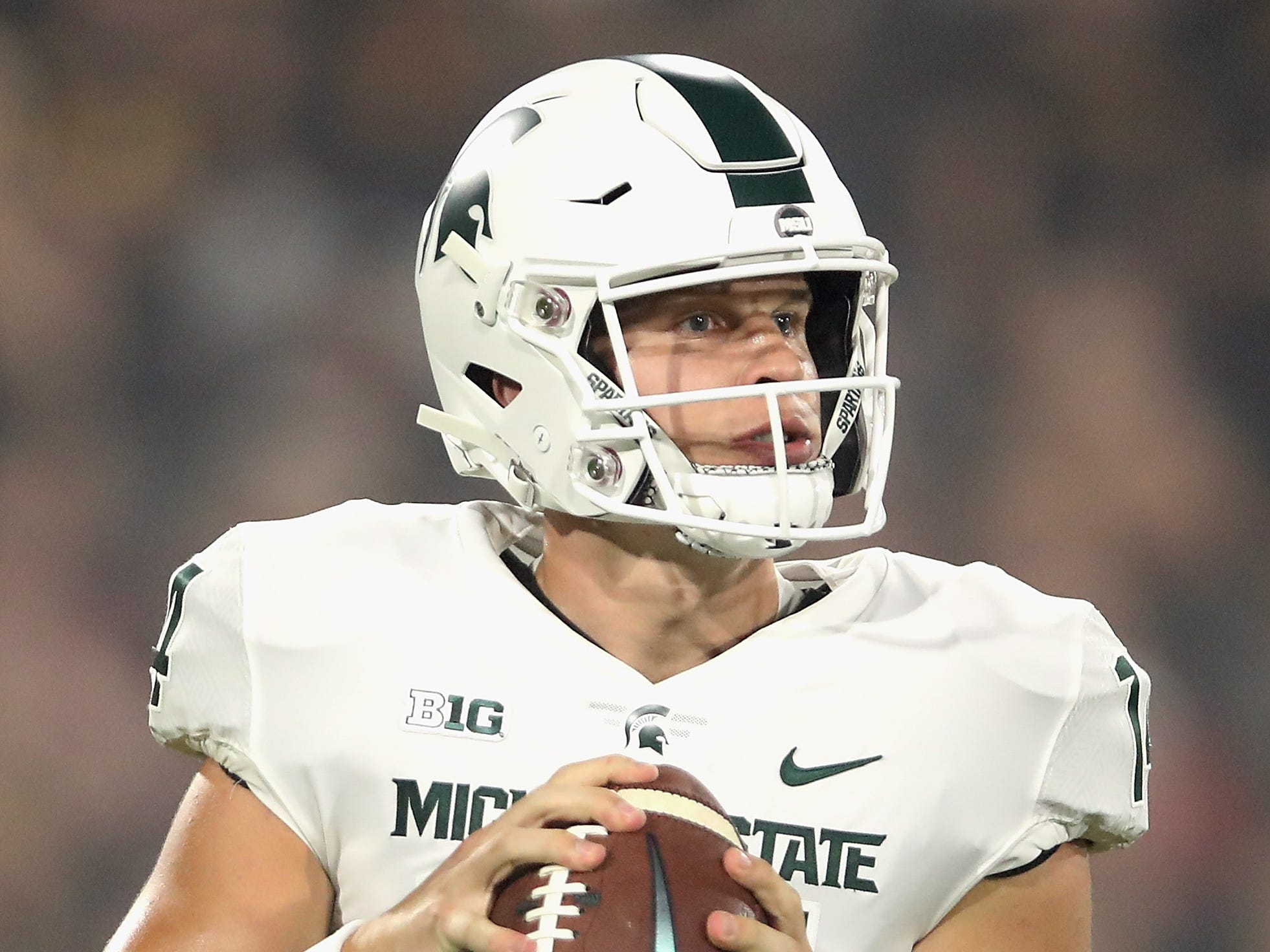 Quarterback Brian Lewerke #14 of the Michigan State Spartans drops back to pass during the first half of the college football game against the Arizona State Sun Devils at Sun Devil Stadium on September 8, 2018 in Tempe, Arizona.