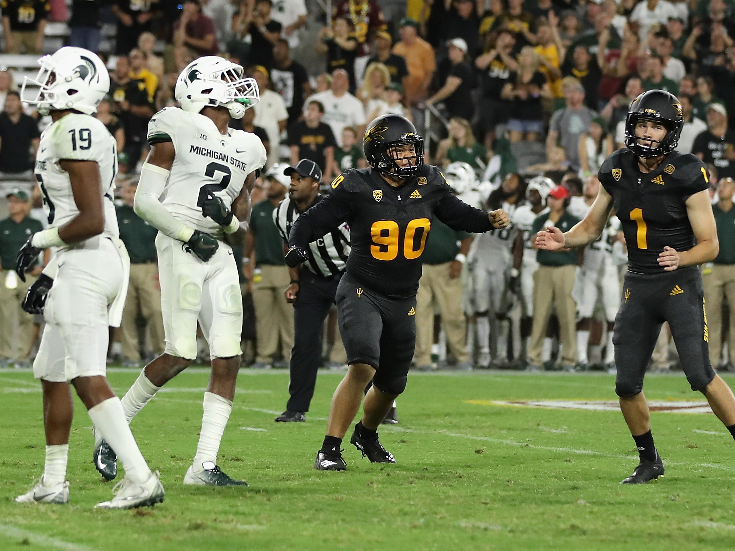 Place kicker Brandon Ruiz #1 (R) of the Arizona State Sun Devils celebrates after kicking the game winning 28 yard field goal against the Michigan State Spartans in the college football game at Sun Devil Stadium on September 8, 2018 in Tempe, Arizona.  The Sun Devils defeated the Spartans 16-13.