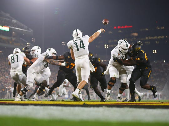 Michigan State Spartans quarterback Brian Lewerke (14) throws a pass against the Arizona State Sun Devils in the first half at Sun Devil Stadium.