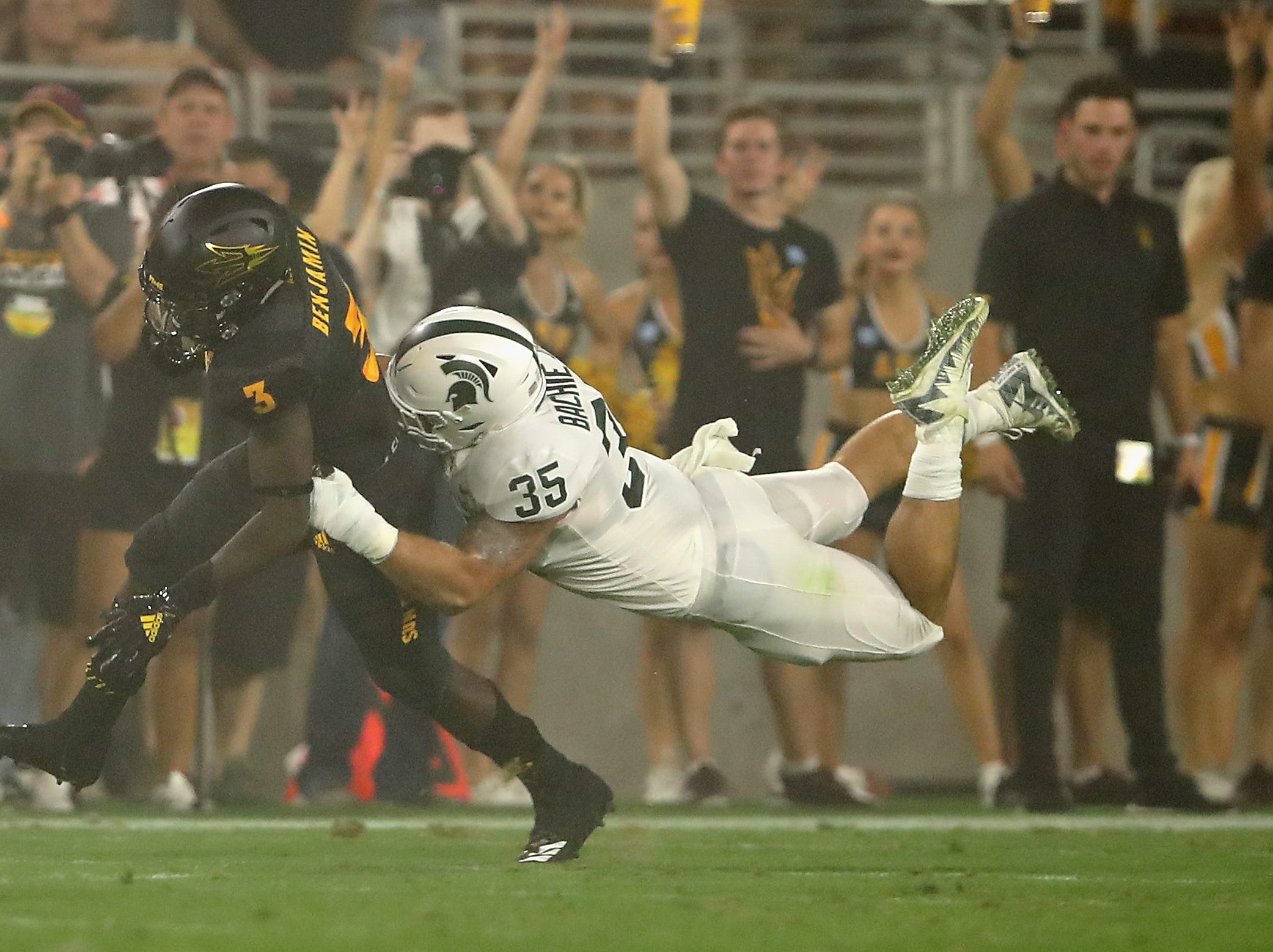 TEMPE, AZ - SEPTEMBER 08:  Running back Eno Benjamin #3 of the Arizona State Sun Devils rushes the football under pressure from linebacker Joe Bachie #35 of the Michigan State Spartans during the first half of the college football game at Sun Devil Stadium on September 8, 2018 in Tempe, Arizona.  (Photo by Christian Petersen/Getty Images)
