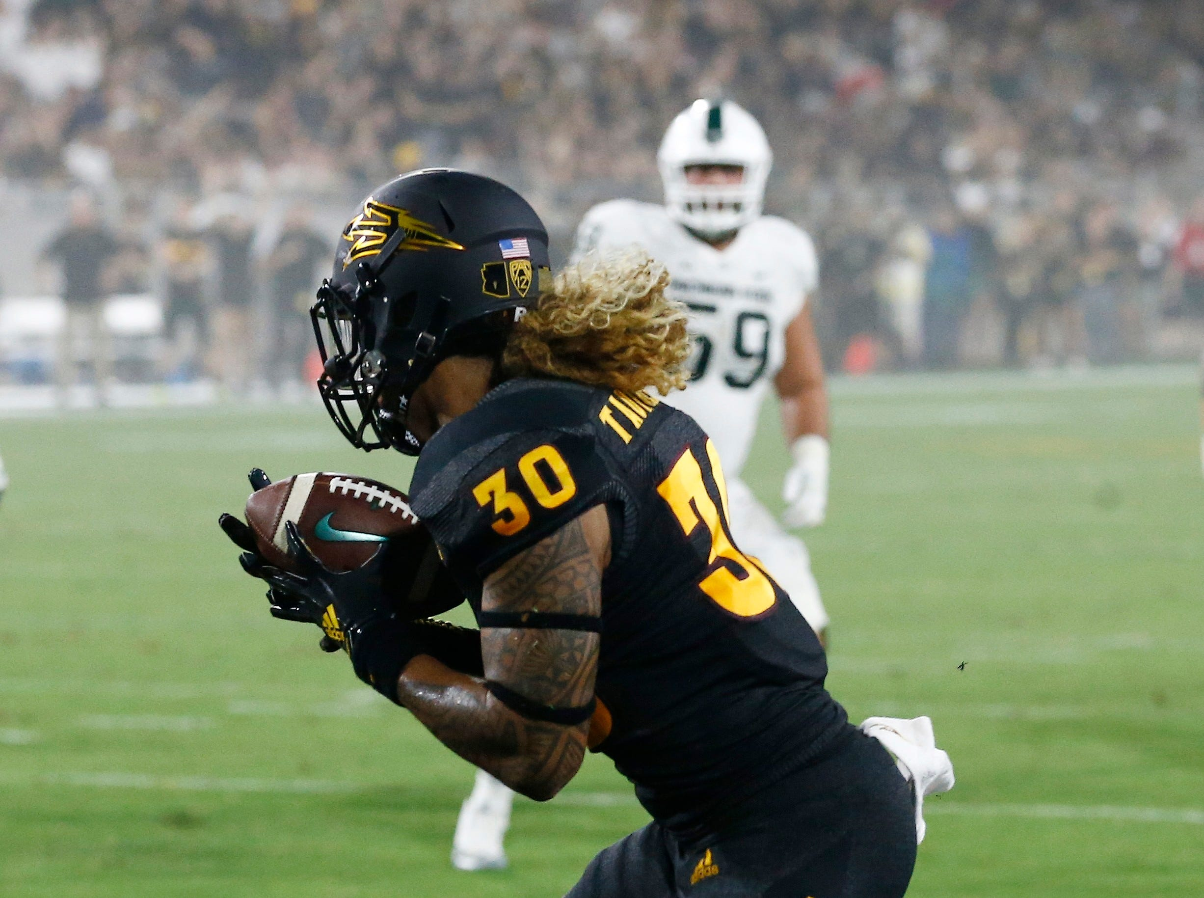 Arizona State defensive back Dasmond Tautalatasi (30) intercepts a pass in the end zone during the first half of an NCAA college football game against Michigan State on Saturday, Sept. 8, 2018, in Tempe, Ariz. (AP Photo/Ross D. Franklin)