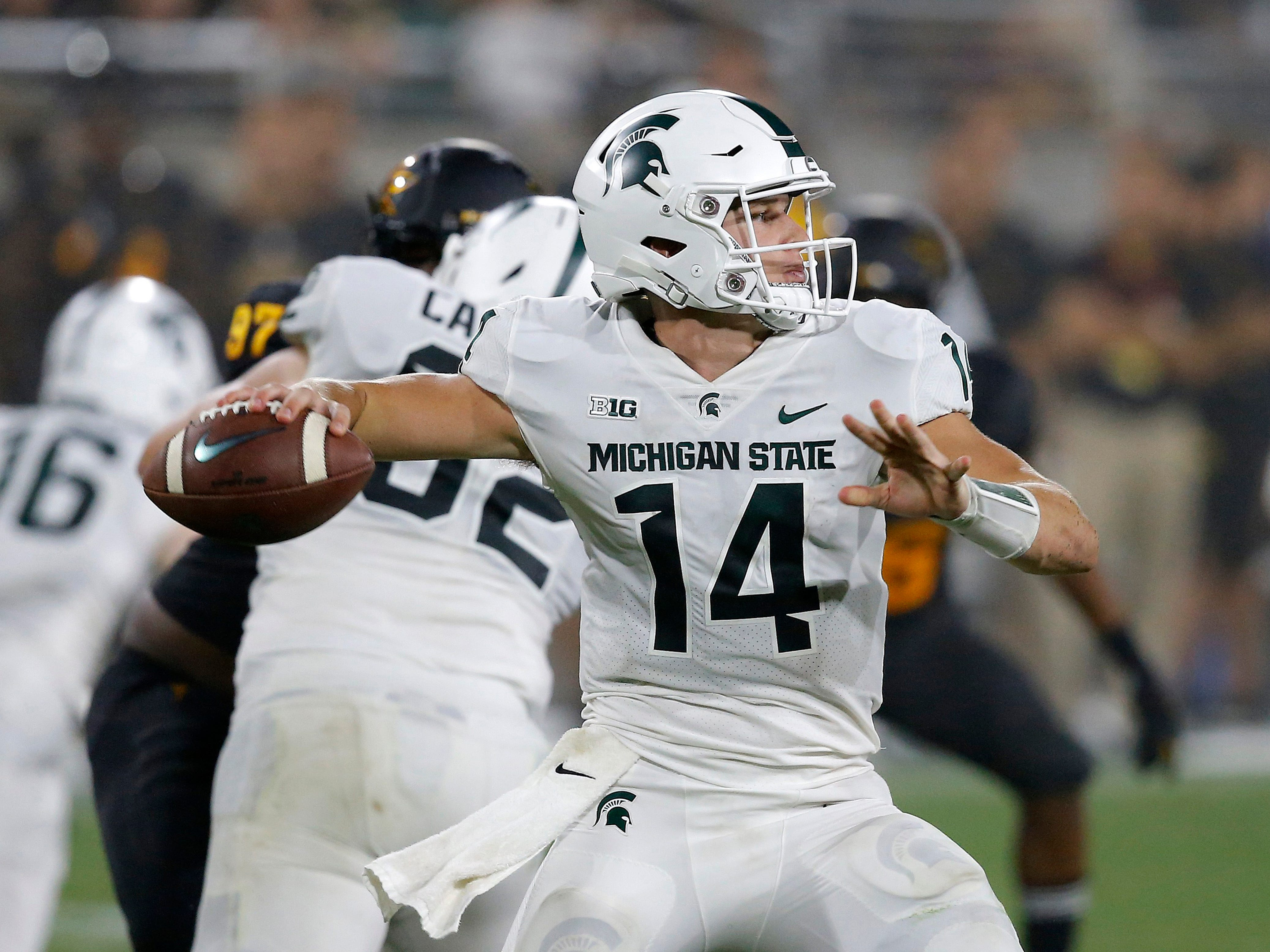 Michigan State quarterback Brian Lewerke throws a pass against Arizona State during the second half of an NCAA college football game Saturday, Sept. 8, 2018, in Tempe, Ariz. Arizona State defeated Michigan State 16-13.