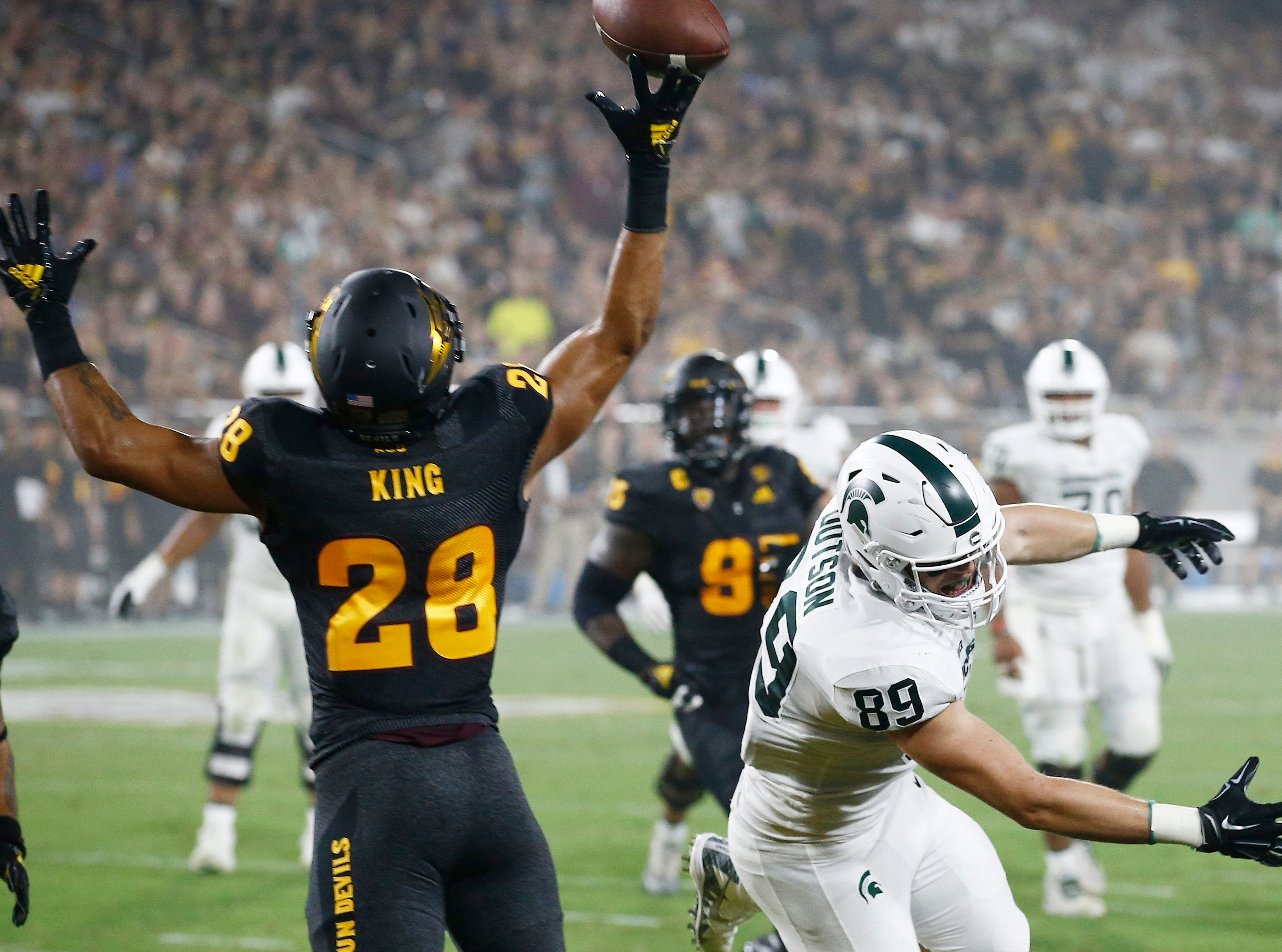 Arizona State defensive back Demonte King (28) tips a pass intended for Michigan State tight end Matt Dotson (89) during the first half of an NCAA college football game Saturday, Sept. 8, 2018, in Tempe, Ariz. (AP Photo/Ross D. Franklin)