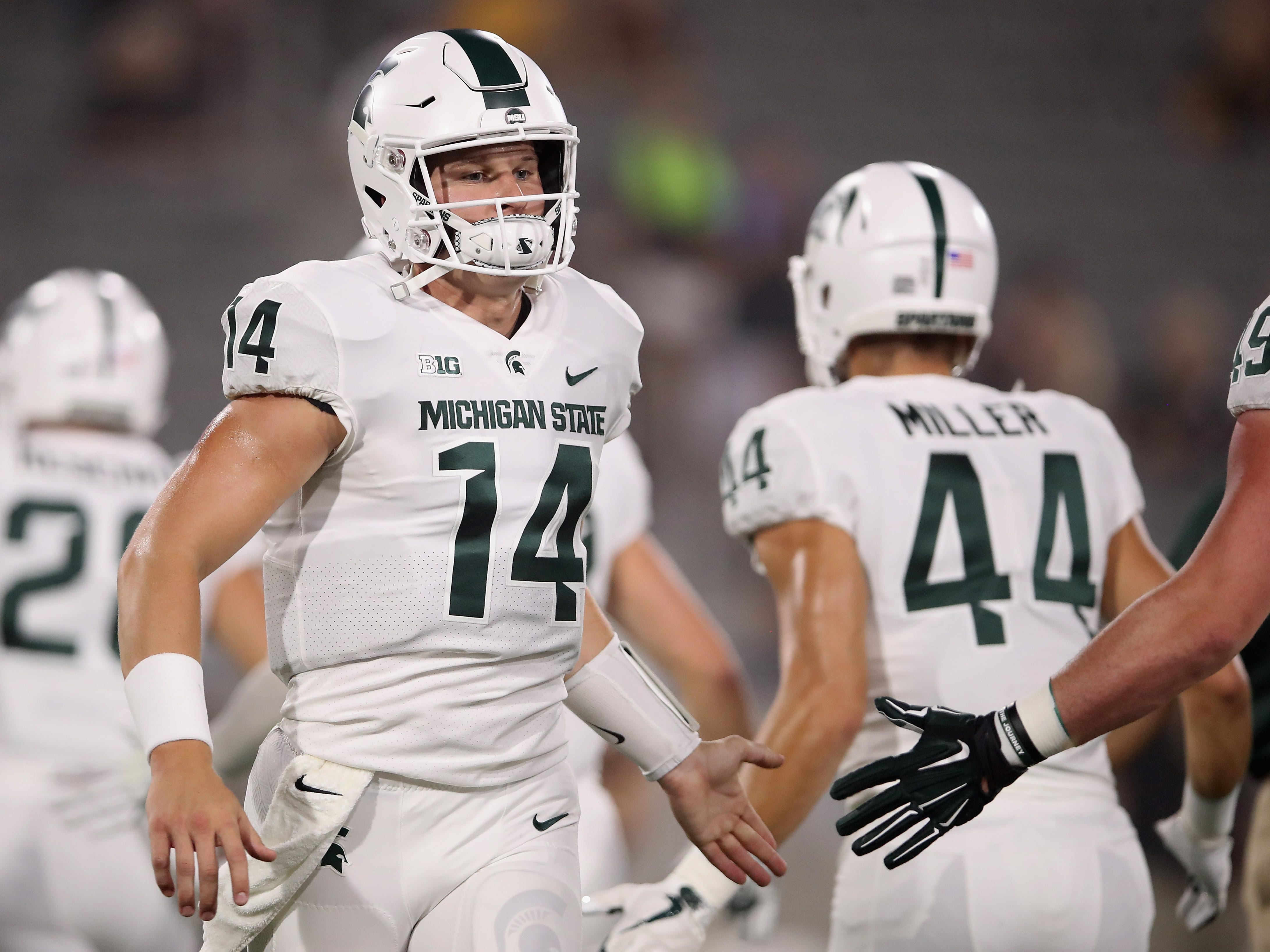 Quarterback Brian Lewerke #14 of the Michigan State Spartans warms up before the college football game against the Arizona State Sun Devils at Sun Devil Stadium on September 8, 2018 in Tempe, Arizona.