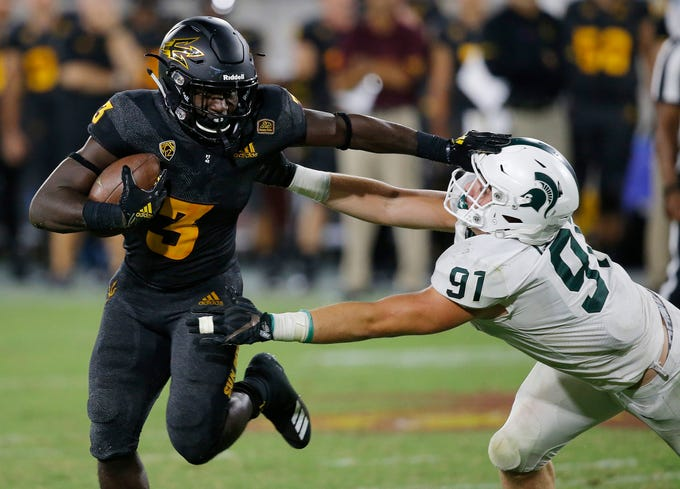 Arizona State running back Eno Benjamin (3) gives Michigan State defensive end Jack Camper (91) a stiff arm as he tries to get past during the second half of an NCAA college football game Saturday, Sept. 8, 2018, in Tempe, Ariz. Arizona State defeated Michigan State 16-13.
