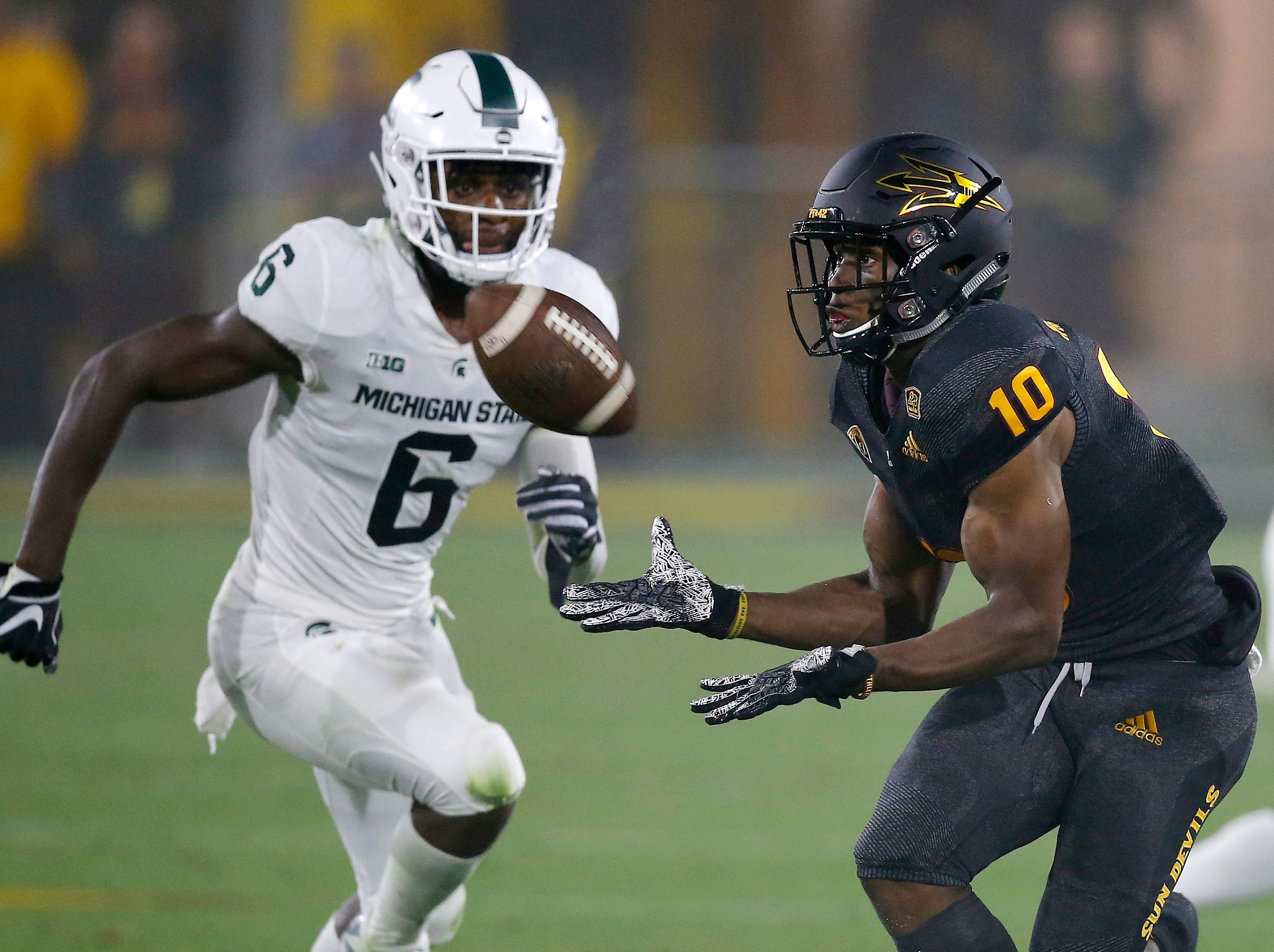 Arizona State wide receiver Kyle Williams (10) makes a catch in front of Michigan State safety David Dowell (6) during the first half of an NCAA college football game Saturday, Sept. 8, 2018, in Tempe, Ariz. (AP Photo/Ross D. Franklin)