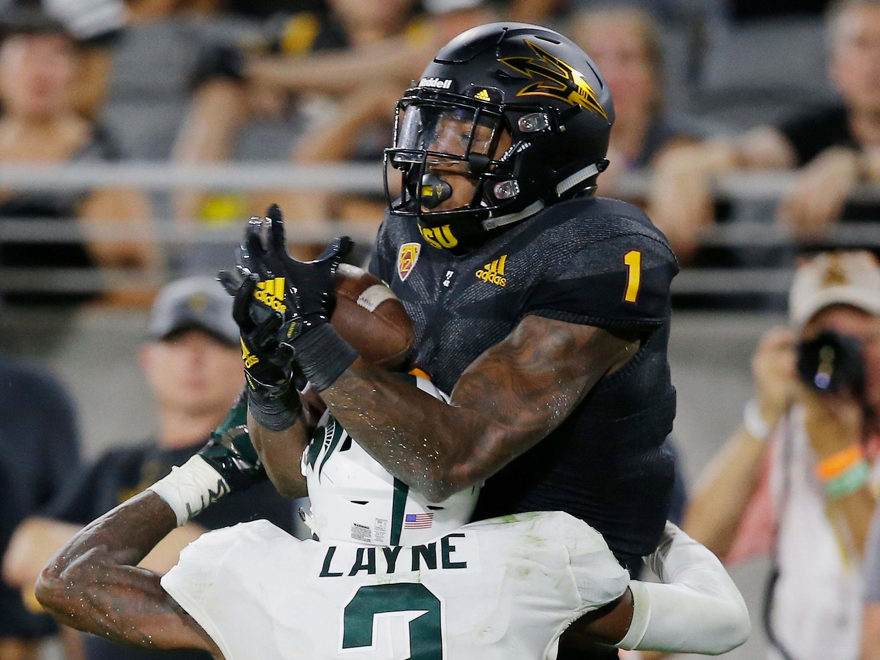 Arizona State wide receiver N'Keal Harry (1) makes a catch over Michigan State cornerback Justin Layne (2) before diving into the end zone for a touchdown during the second half of an NCAA college football game Saturday, Sept. 8, 2018, in Tempe, Ariz. Arizona State defeated Michigan State 16-13.