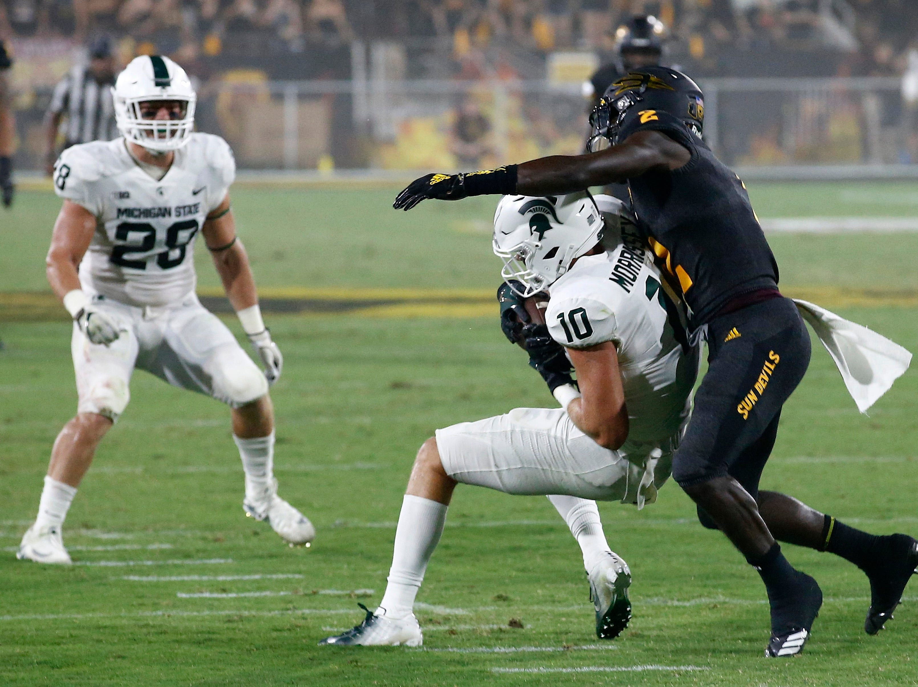 Michigan State safety Matt Morrissey (10) intercepts a pass intended for Arizona State wide receiver Brandon Aiyuk (2) as Michigan State linebacker Jon Reschke (28) watches during the first half of an NCAA college football game Saturday, Sept. 8, 2018, in Tempe, Ariz. (AP Photo/Ross D. Franklin)