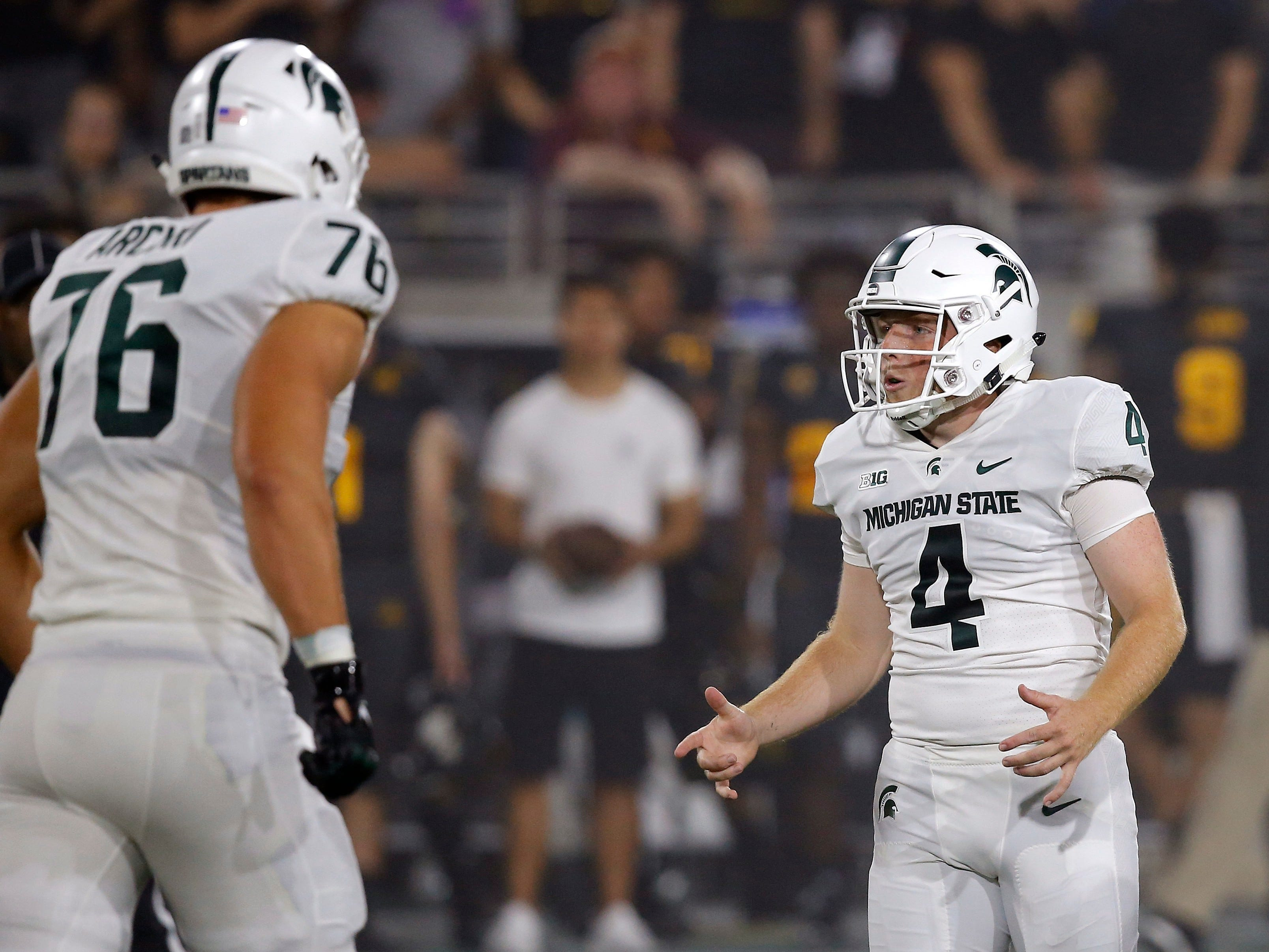 Michigan State kicker Matt Coghlin (4) celebrates his field goal against Arizona State with offensive tackle AJ Arcuri (76) during the first half of an NCAA college football game Saturday, Sept. 8, 2018, in Tempe, Ariz.