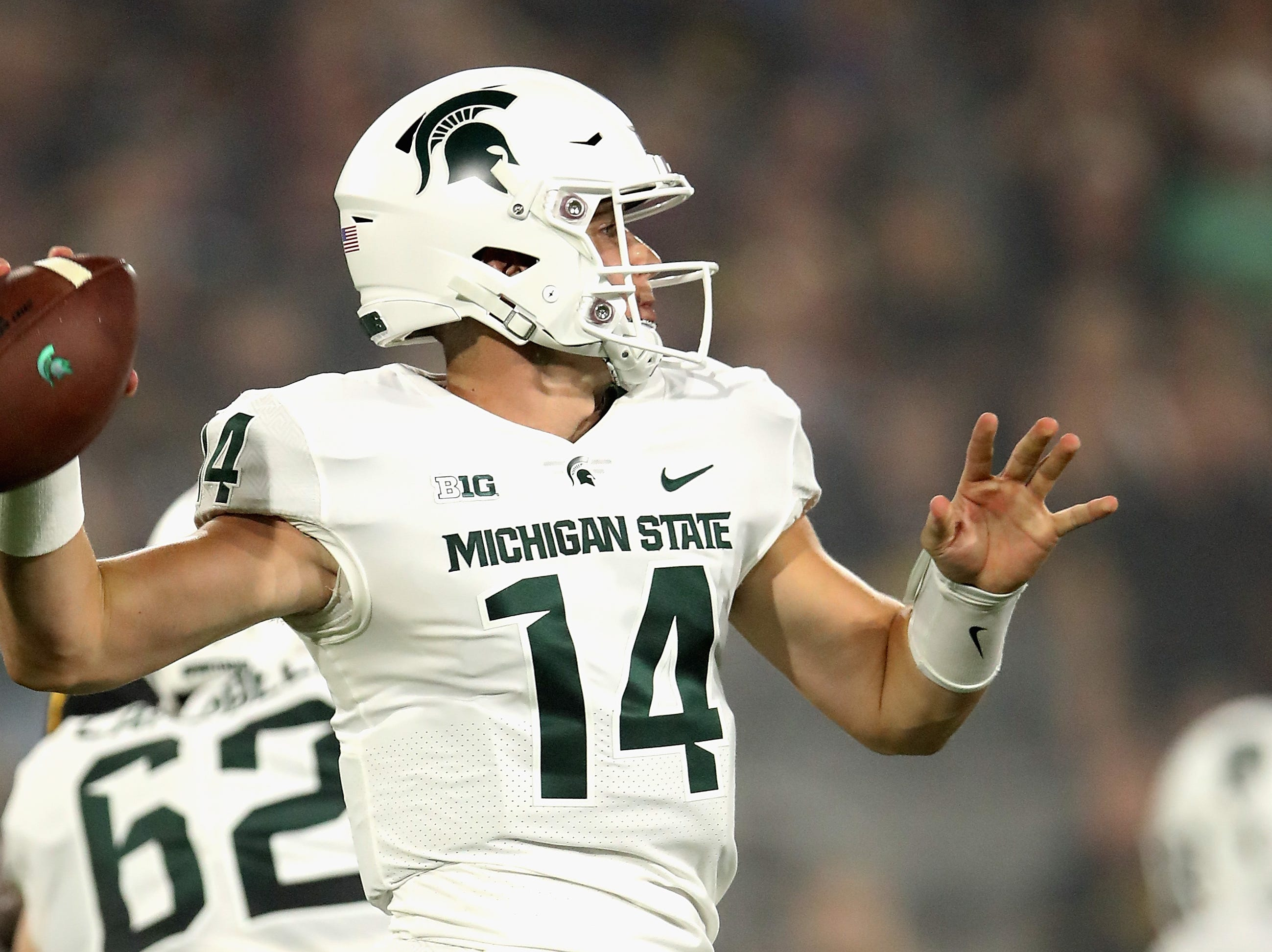 TEMPE, AZ - SEPTEMBER 08:  Quarterback Brian Lewerke #14 of the Michigan State Spartans drops back to pass during the first half of the college football game against the Arizona State Sun Devils at Sun Devil Stadium on September 8, 2018 in Tempe, Arizona.  (Photo by Christian Petersen/Getty Images)