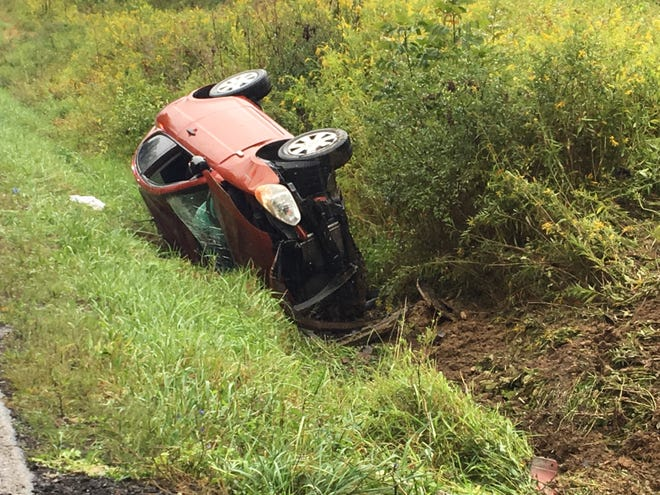 Two people were injured in a one-vehicle rollover on West Hanley Road on Sunday, Sept. 9, 2018.