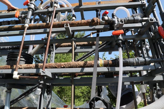 September 5, 2018 Staff from the Waukesha Water Utility worked with City of Milwaukee to install test apparatus in the Grange Pumping Station of the Milwaukee Water Utility.  The test apparatus contains actual older cast iron service pipes from the street in Waukesha, and in home copper water pipes with lead solder joints.  Milwaukee water will be run through the pipes for serveral months to determine if lead leaches out of the solder and other buildup leaches out of the cast iron service pipes.  This is part of the preparation for Milwaukee water being piped and sold to Waukesha.  Here the test apparatus, with cast iron service pipes pulled from under Waukesha streets and copper pipes with lead solder pulled right out of Waukesha homes.   MICHAEL SEARS/MSEARS@JOURNALSENTINEL.COM