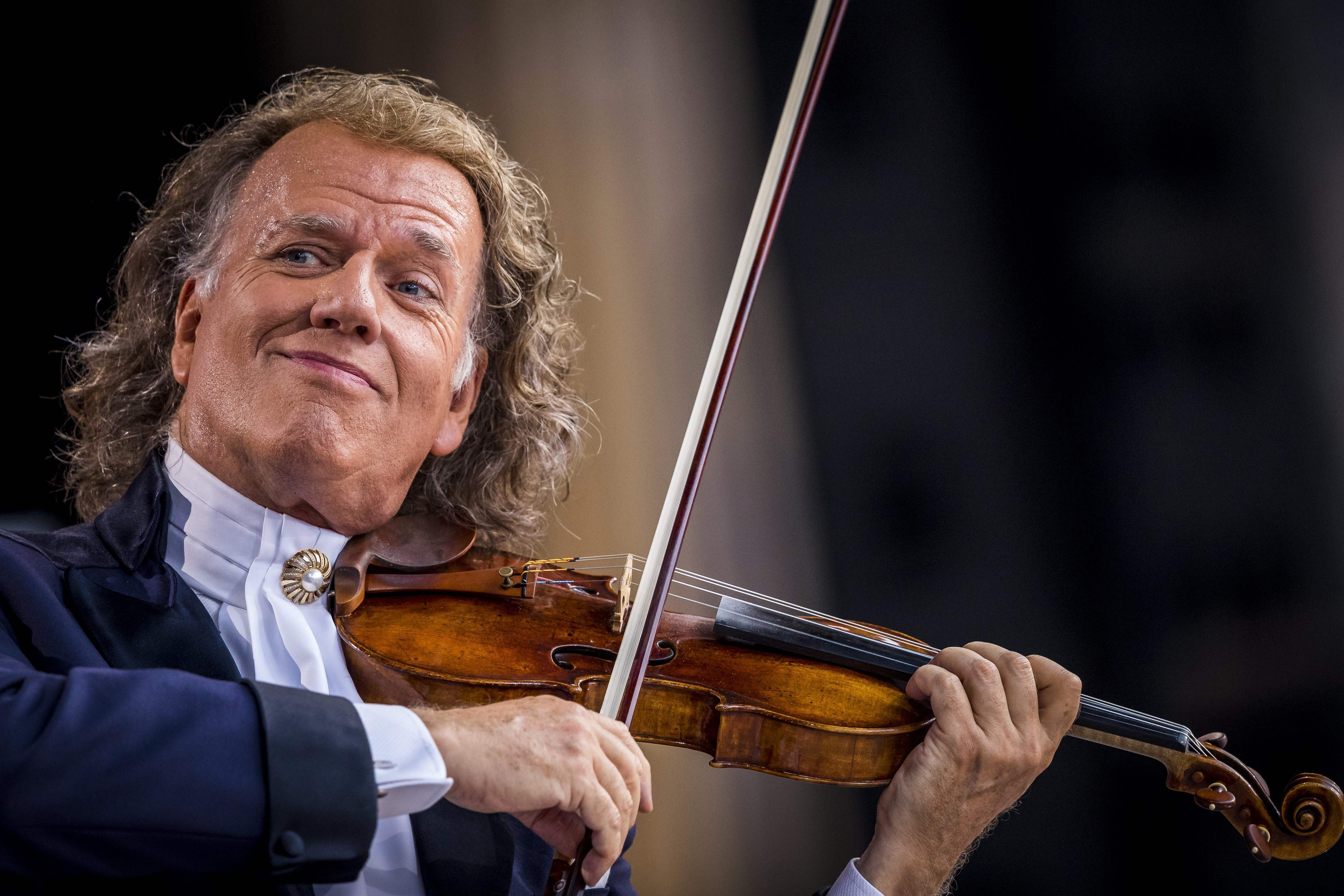 Andre Rieu leads his Johann Strauss Orchestra in a concert at the UW-Milwaukee Panther Arena Saturday.