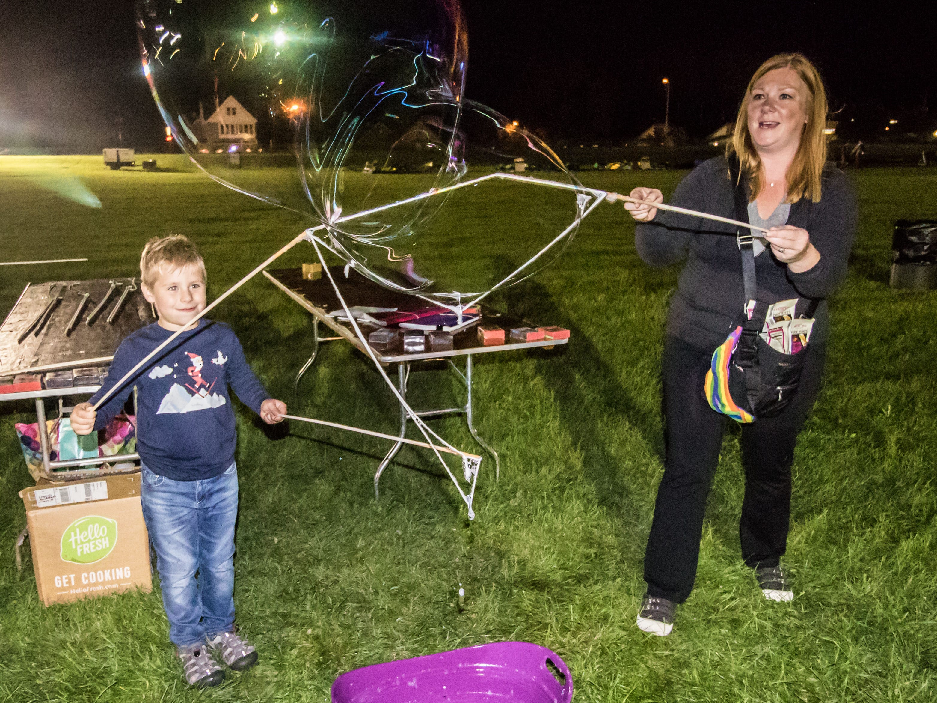 Logan Kittelson, 6, and Alison Due, both of Wauwatosa, create gigantic bubbles during TosaFest 2018 at Hart Park on Friday, Sept. 7. The free two-day event features live music, food, kids activities and more.