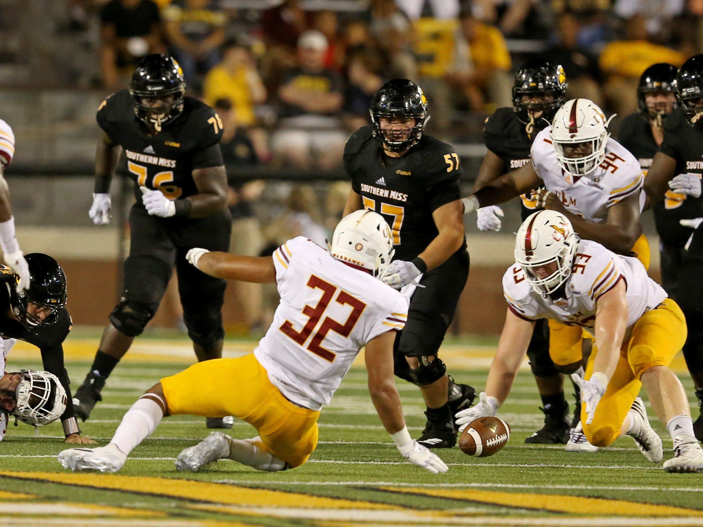 Sep 8, 2018; Hattiesburg, MS, USA; Louisiana Monroe Warhawks defensive tackle Mason Husmann (93) recovers a fumble by Southern Miss Golden Eagles quarterback Jack Abraham (15) in the third quarter at M. M. Roberts Stadium. The Louisiana Monroe Warhawks won, 21-20. Mandatory Credit: Chuck Cook-USA TODAY Sports