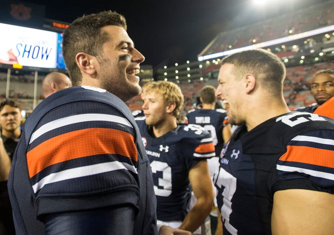 Auburn's Jarrett Stidham (8) jokes with teammates after the game at Jordan-Hare Stadium in Auburn, Ala., on Saturday, Sept. 8, 2018. Auburn defeated Alabama State 63-9.